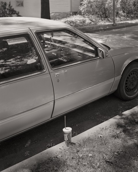 Cup and car