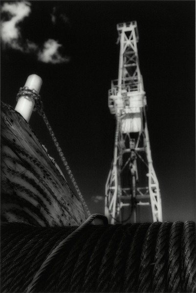 Oil Derrick and Wispy Clouds