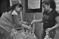 Leonila and Claudia filling water bottles