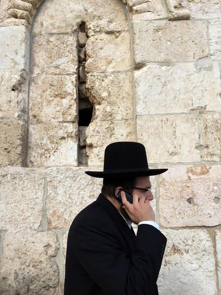 Ultra-Orthodox on mobile, Jerusalem, Israel