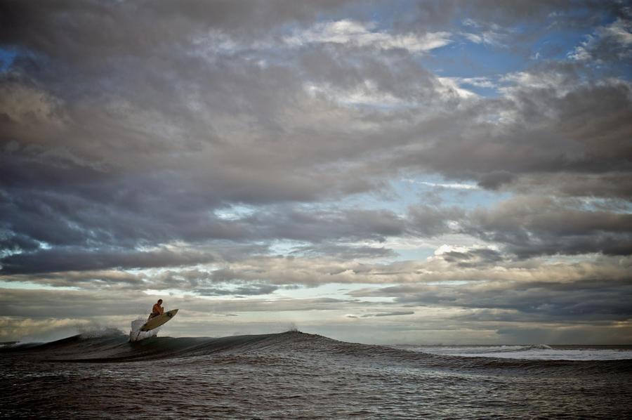 Surfing in Samoa.