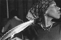 Woman in Scarf with Fan