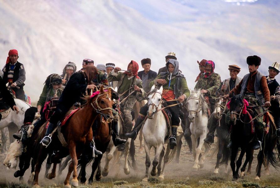Kyrgyz men play 'buzkashi', Afghan Pamirs