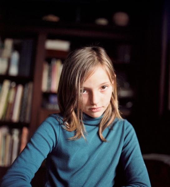 Audrey in a blue shirt