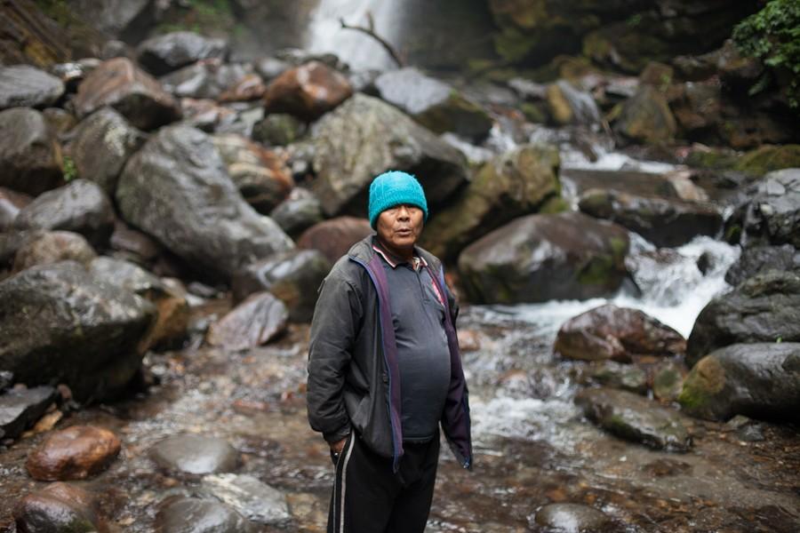 Man by Waterfall (Pelling), 2013
