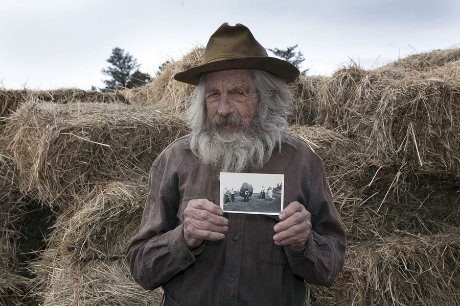 John with photo of his grandfather