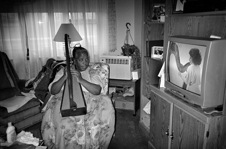 Hattie Learning to Play the harp, Utica, NY 2002